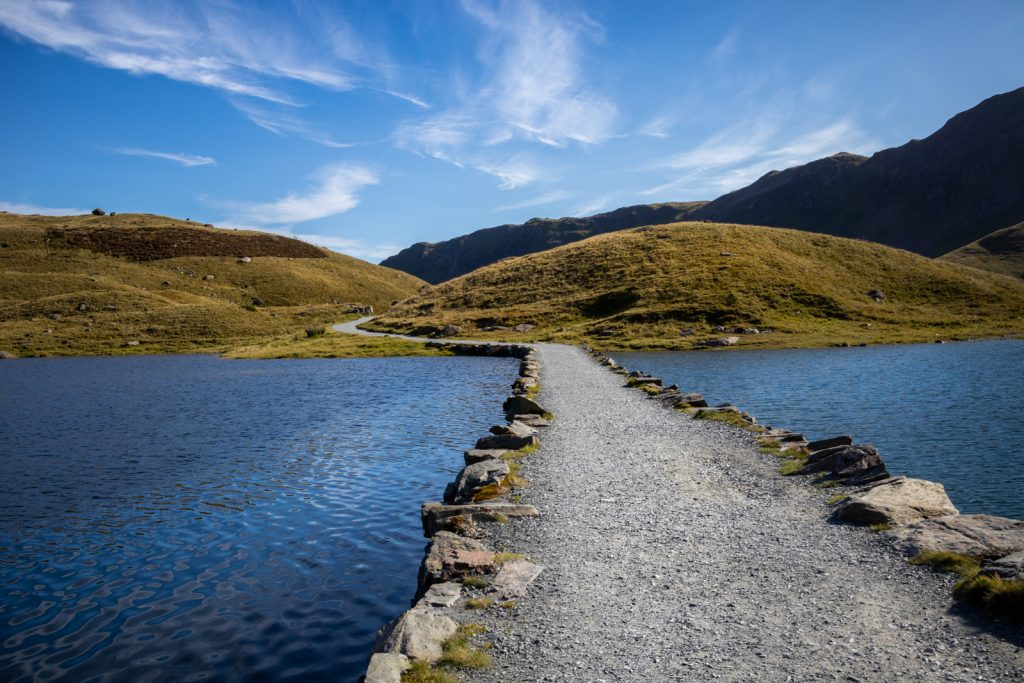 A footpath crossing the lakes along the Miner's Path in Snowdon