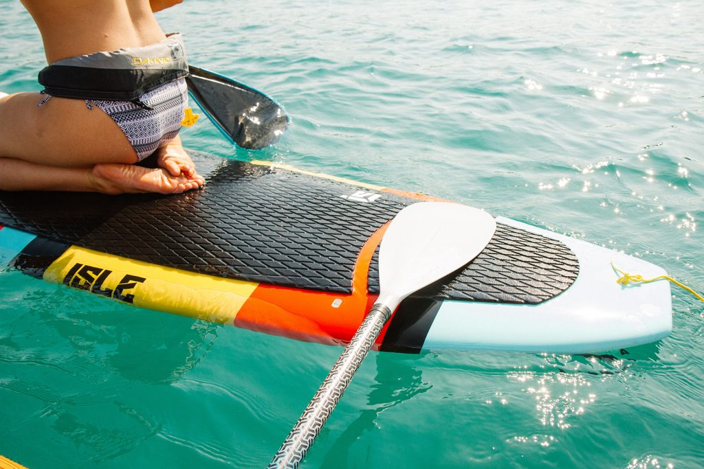 A paddleboard paddle and the tail of the board