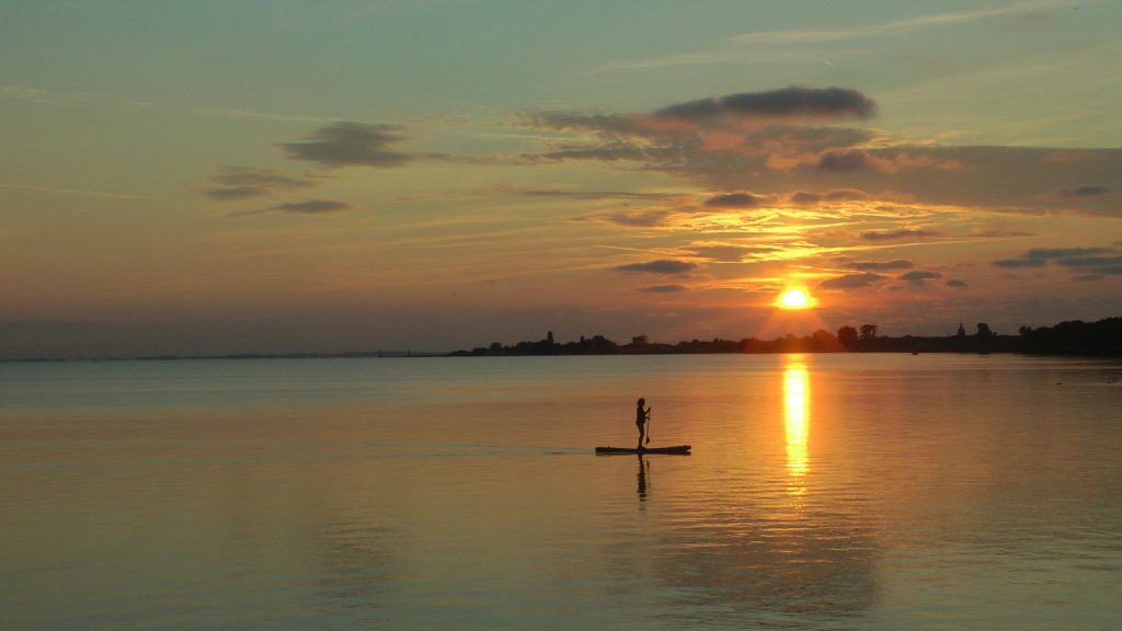 Paddleboarding during a beautiful sunset