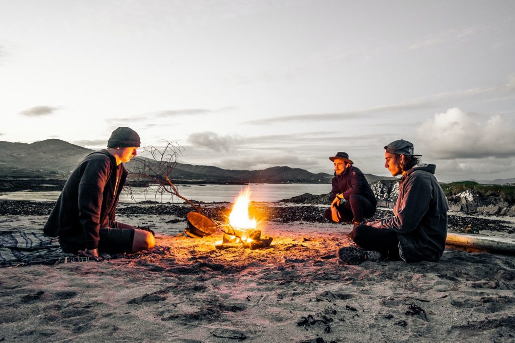 Enjoying the heat of a campfire whilst camping